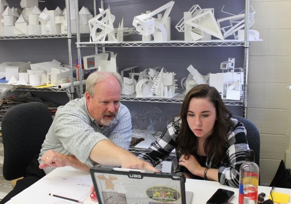 Associate Professor Alex Poorman, who was recently awarded the IFDA Education Foundation's Irma Dobkin Universal Design Grant, works with second year student Alanna Wilson. Photo by Meghan McCandless